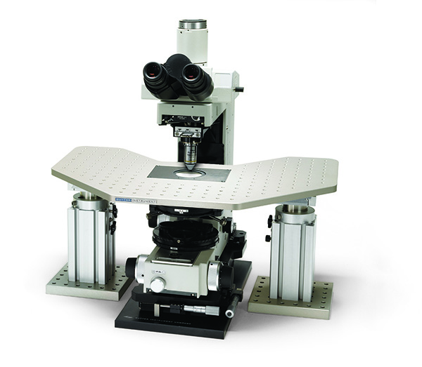 X-Y Translation systems for fixed-stage microscopes